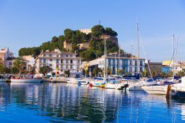 Denia Port with castle hill and marina boats in Alicante province Spain